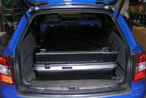 With the rear seats folded down, this huge case just fits inside the