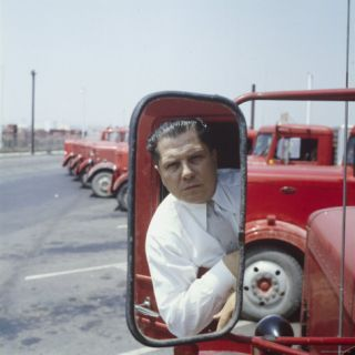 Union President Jimmy Hoffas Image Reflected in Rear View Mirror in Red Truck Premium Photographic Print by Hank Walker