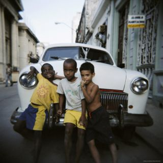 Three Young Boys Posing Against Old White American Car, Havana, Cuba, West Indies, Central America Photographic Print by Lee Frost