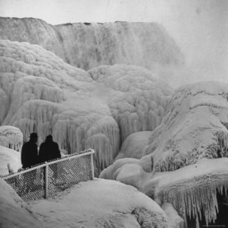 Frozen Niagara Falls, Trees, Park Grounds and Rocks Covered with Ice and Mist Photographic Print by Andreas Feininger