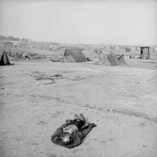 Dead Inmate of Bergen Belsen Concentration Camp After Liberation of Camp by Allied Troops Photographic Print by George Rodger