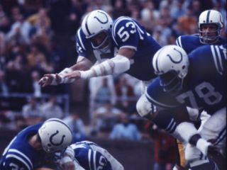 Baltimore Colts Football Player Dennis Gaubatz in Action Premium Photographic Print by Art Rickerby