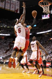 Chicago Bulls v Miami Heat   Game Three, Miami, FL   MAY 22: Carlos Boozer and LeBron James Photographic Print by Mike Ehrmann