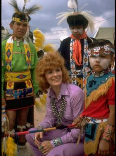 Jill St. John Wearing Turquoise Jewelry Surrounded by Colorfully Costumed Navajo Children Premium Photographic Print by Michael Mauney