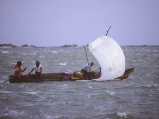 Fishermen on the Sea at San Mateo Del Mar in a Small Sail Driven Boat Photographic Print by Kent Kobersteen