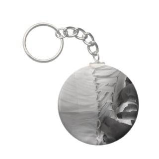 Female hand lacing up wedding dress back key chain
