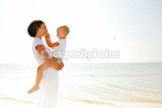 Mother holding the son on sea beach  Stock Photo © Vitaly Valua
