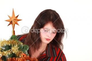 Young woman decorating christmas tree  Stock Photo © Tom Prokop