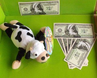 Slingshot Flying Cow Mooing Sound and 10 Santa Bucks Toys